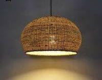 Hanging rustic lamp with a golden bulb
