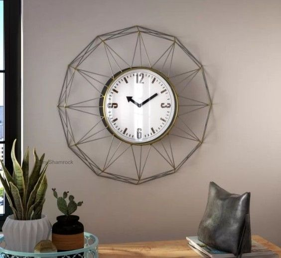Rounded white wall clock made with glass and metal