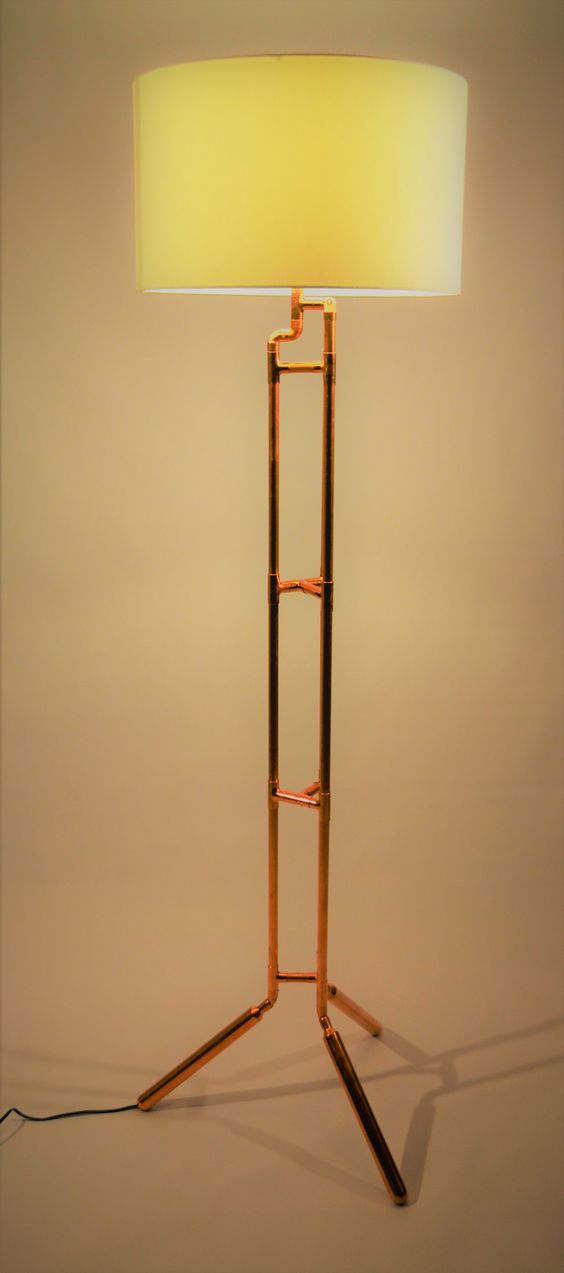 Simple looking golden light standing floor lamp