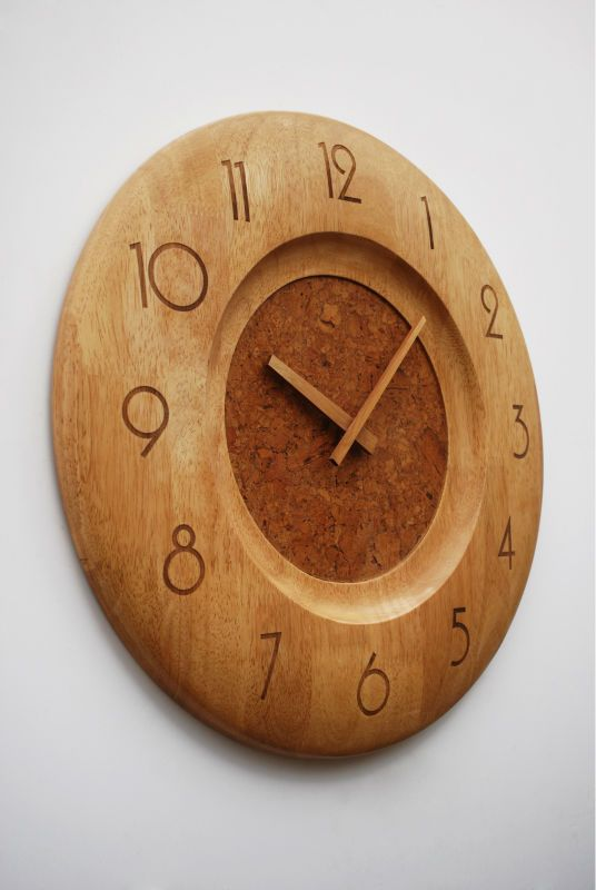 Oval shape wooden wall clock in brown shade
