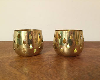Set of two candle holders made with brass