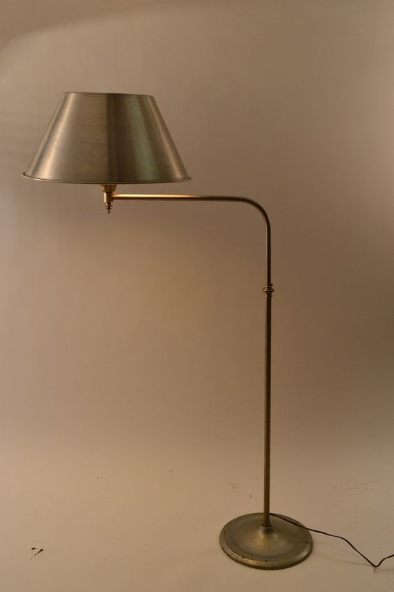 Gold color floor lamp with simple brass finishing