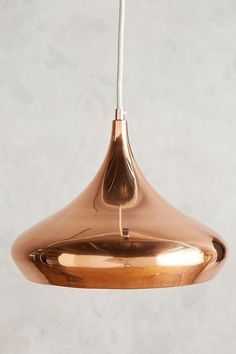 Copper colored hanging lamp with white wire