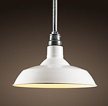 White shaded pendant lamp with golden bulb