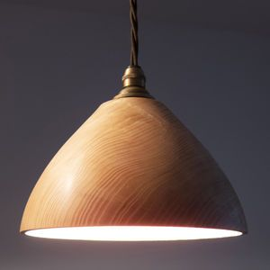 Brown wooden hanging lamp with golden lighting