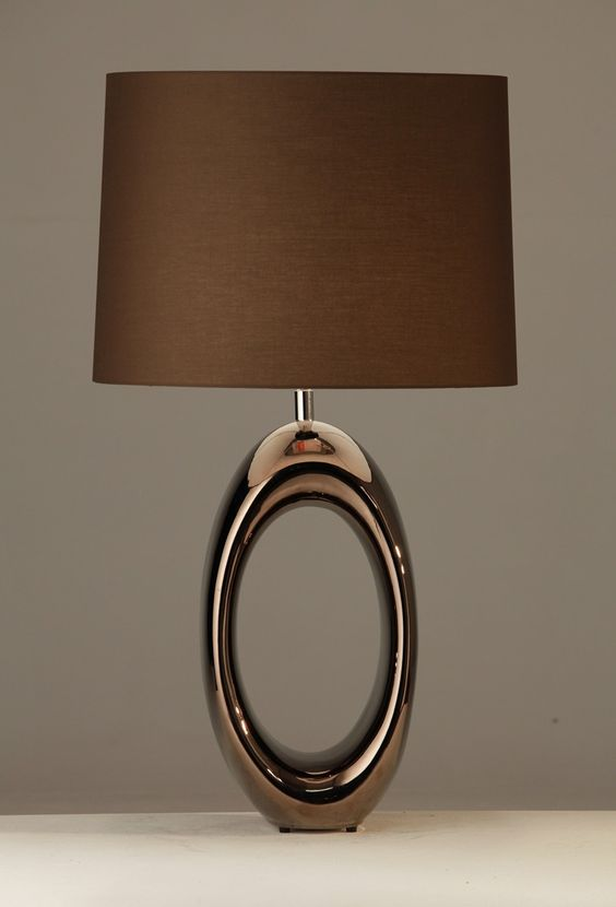 Dark brown table lamp with a silver oval finishing
