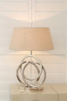 Unbleached silk color Table lamp in creative ring shape base